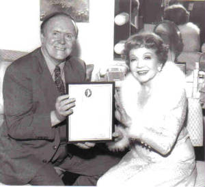 Larry Quirk gives award to Claudette Colbert